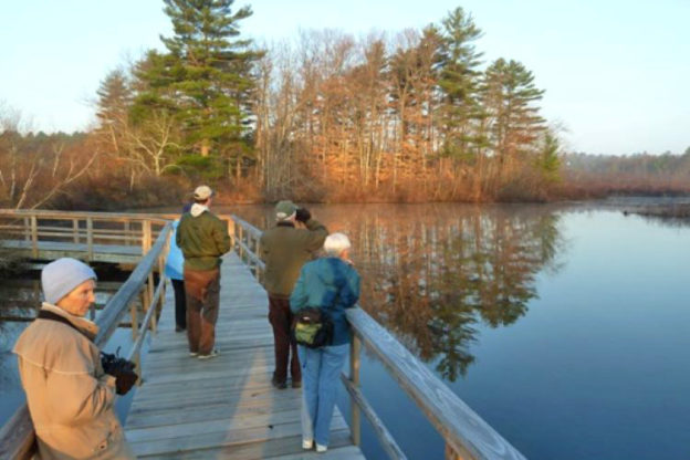 Group taking nature hike across boardwalk in March