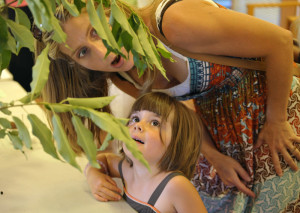 Mother and daughter at a live caterpillar show seeing a cecropia moth caterpillar for the first time.  © Samuel Jaffe