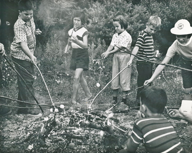 Wildwood campers roast marshmallows over a campfire circa 1953. Photo © Gordon Hicks