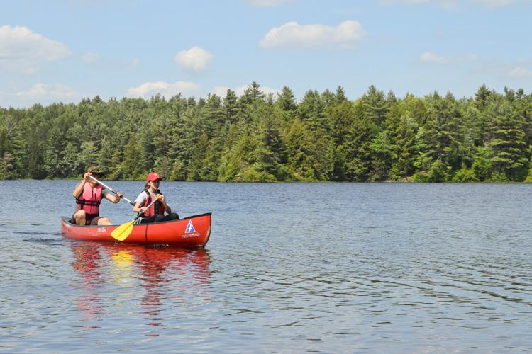 Two counselors enjoying a canoe on Hubbard Pond