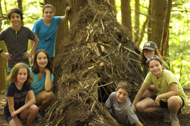 "Wildwood campers showing off a ""gnome home"" they build in the forest"