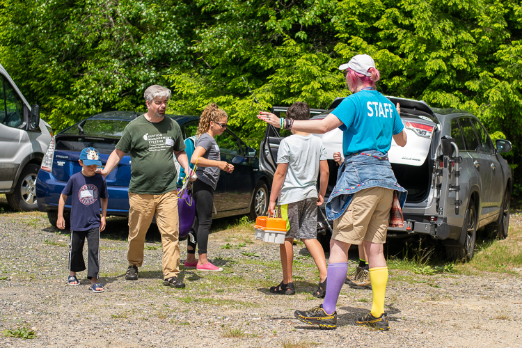 Staff member Gilbert welcomes an arriving family to Wildwood Family Camp