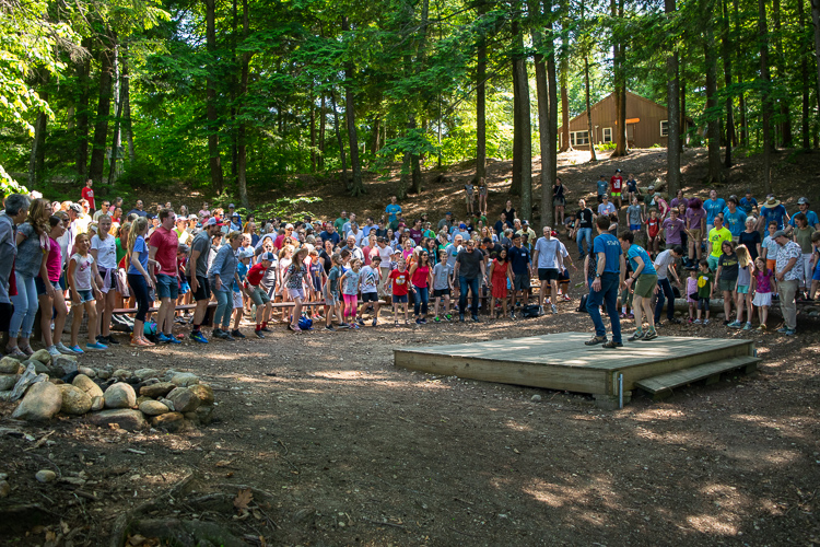 Camp staff welcome families in the amphitheater