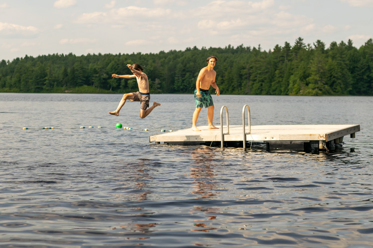These campers played Rock, Paper, Scissors on the dock—loser jumps in the lake!