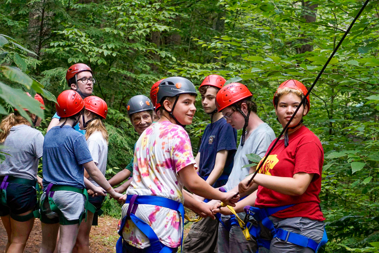 Campers working together on the ropes course