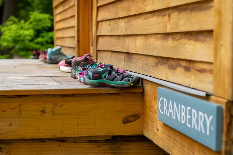 Shoes lined up outside Cranberry cabin in the Fossey unit