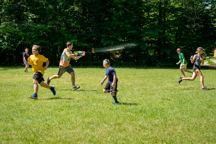 "Counselor Jackson chases campers with a super soaker to choose who is ""it"" first"