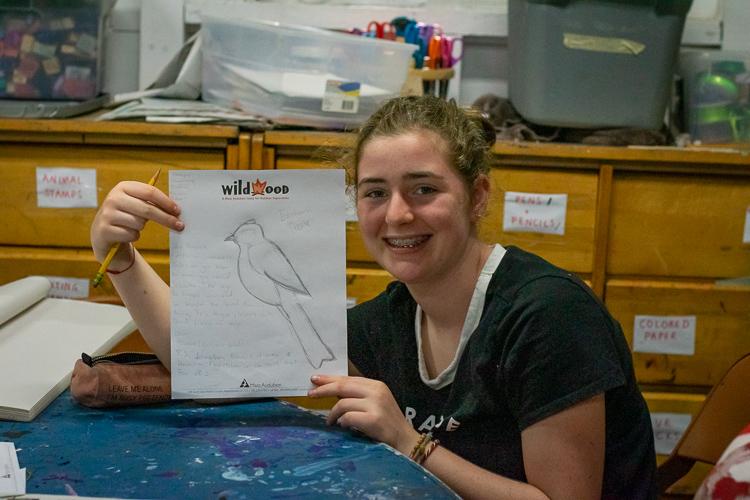 A camper shows off her Bird Art during DGsac