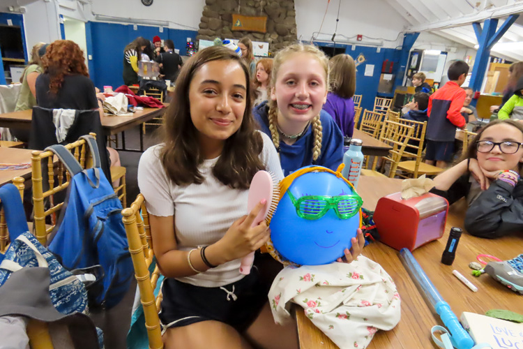 Campers showing off their creations in the dining hall