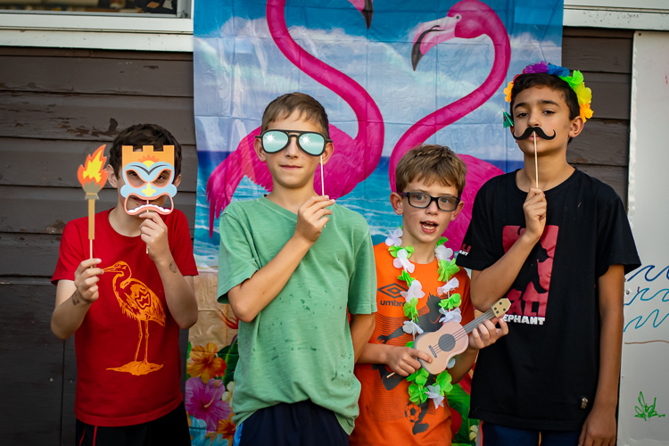 Campers try out some of the props in the photo booth