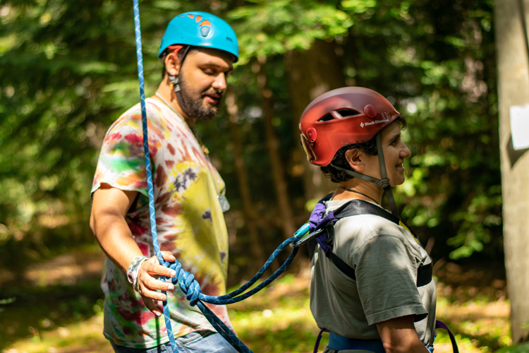 Checking knots and harness attachments at the ropes course