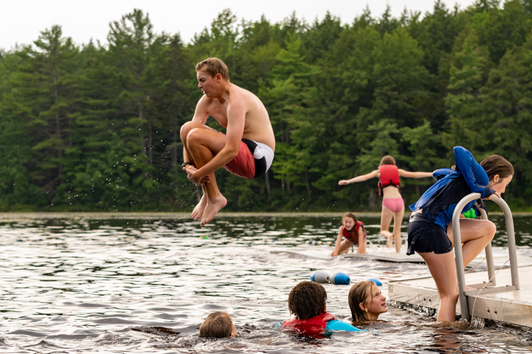 Wildwood 2021 Session 2 Camper does a cannonball off the dock