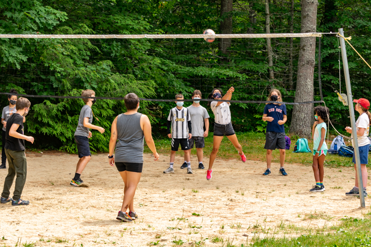 Campers playing volleyball during DGs