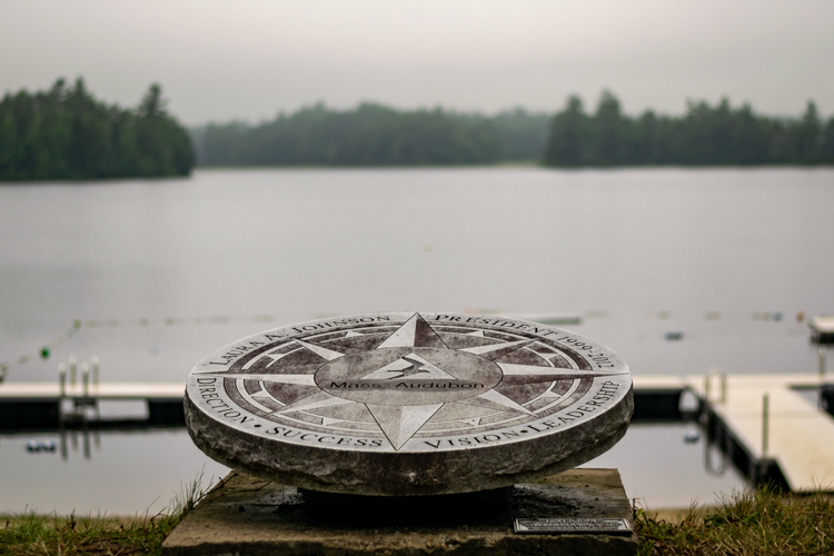 Laura Johnson dedication stone overlooking Hubbard Pond