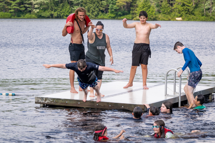 The surprise hit of the session: Rock-Paper-Scissors on the raft! Loser has to jump in the water!
