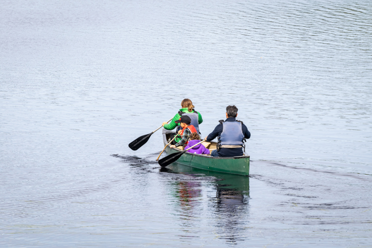 Family canoeing on Hubbard Pond