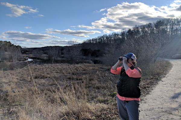 Lauren Kras looking through binoculars