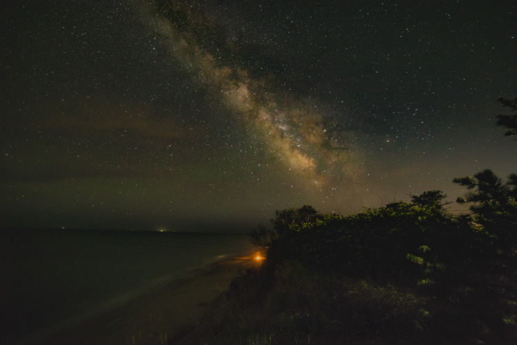 Night sky over a beach