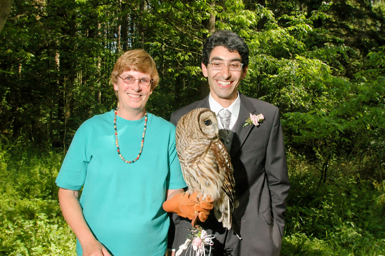 Flavio (right) on his wedding day with his mentor, Bet Ross, and his ring bearer owl, Grinnell