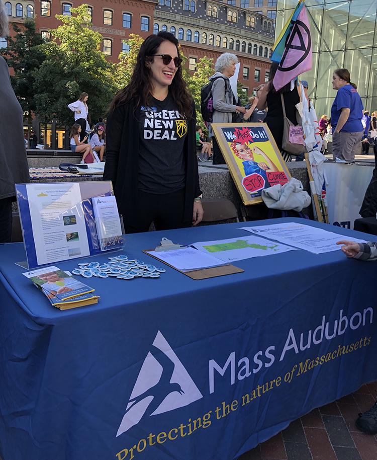 Alexandra Vecchio, Mass Audubon's Climate Change Program Manager at the Mass Audubon table.