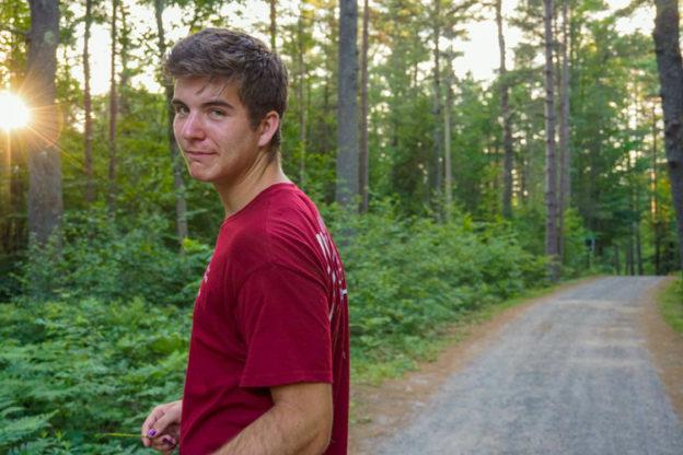 Jackson Lieb walking a Wildwood trail at sunset