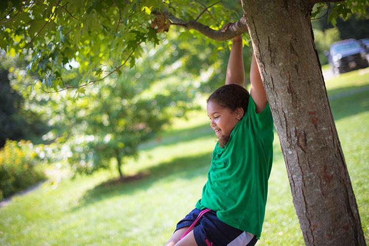 Girl playing on tree