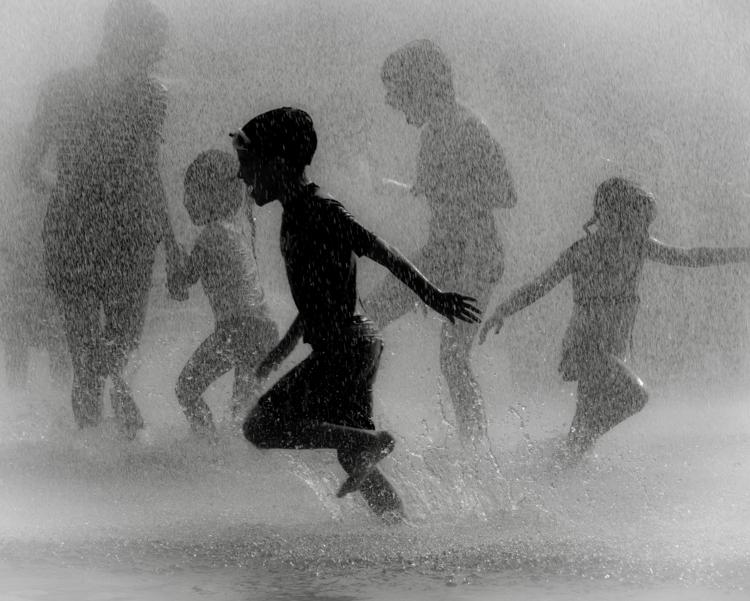 Children playing in a splash park © John Ames