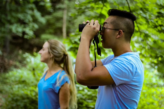 Young woman and man birding
